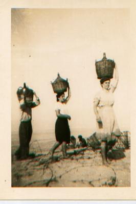 women-wwine-on-heads.jpg